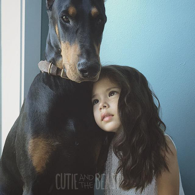 24 Adorable Photos Of Cutie Siena And Her Doberman