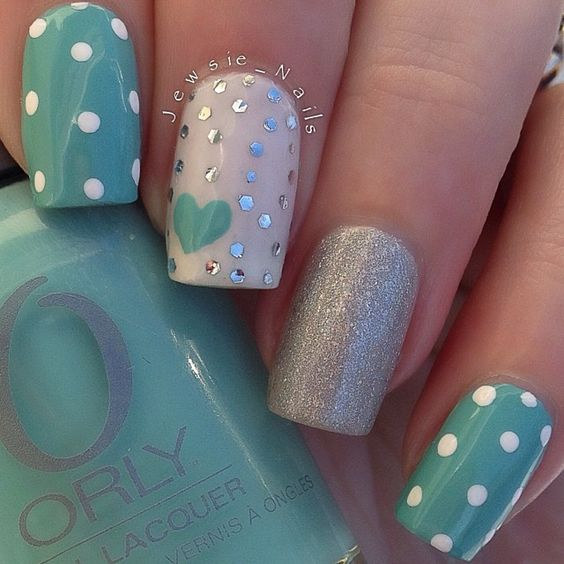 Lovely nail art on turquoise base - 50 Different Polka Dots Nail Art Ideas That Anyone Can DIY