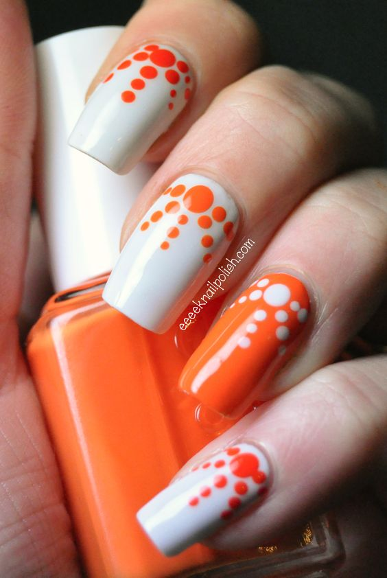 Orange and white polka dots diverging nail art - 50 Different Polka Dots Nail Art Ideas That Anyone Can DIY