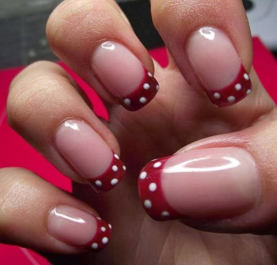 Red tips wtih white  dots on french manicure