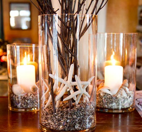 candle holder with shells and stone
