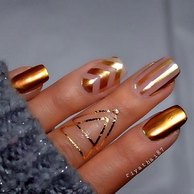trendy negative space and gold nail art