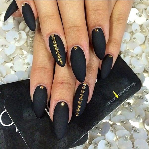 Classy black matte nails with golden studs - 50 Sassy Black Nail Art Designs To Envy