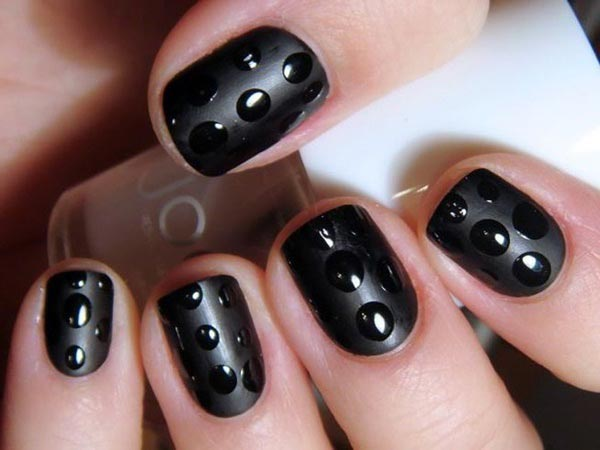 Easy matte black nail art with glossy polka dots