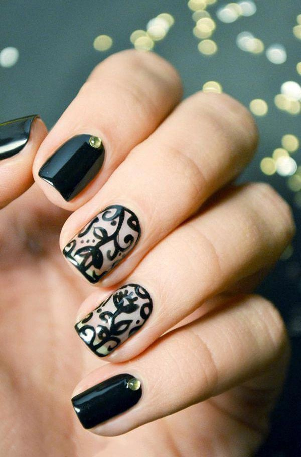 There is no reason to not love such an amazing nail art with stones on black base and lace design on white