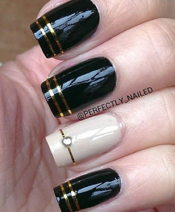 Golden strips on glossy black nail polish