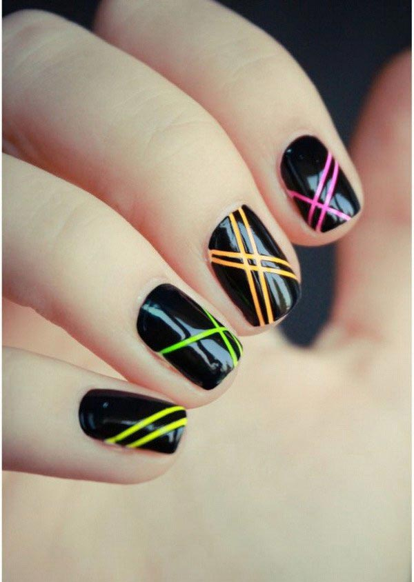 Colorful strips on black glossy nail polish