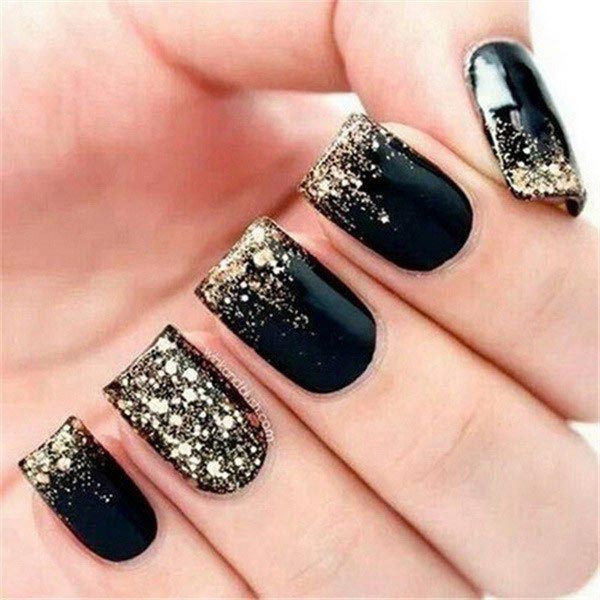 splatter gold nail art on black polish