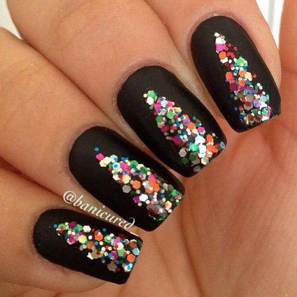 Colourful sequin design on black nails