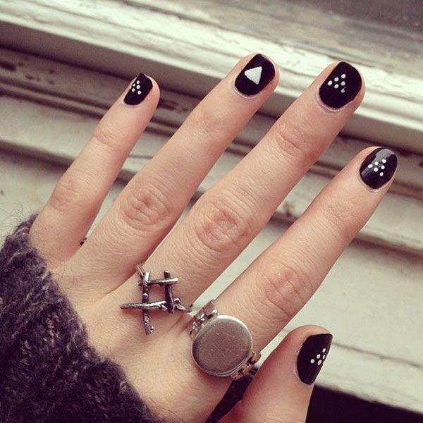 Simple black nail art with polka dots