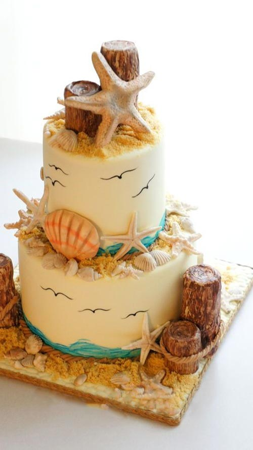Perfect beach wedding cake with sea,bird,sand,shells and everything