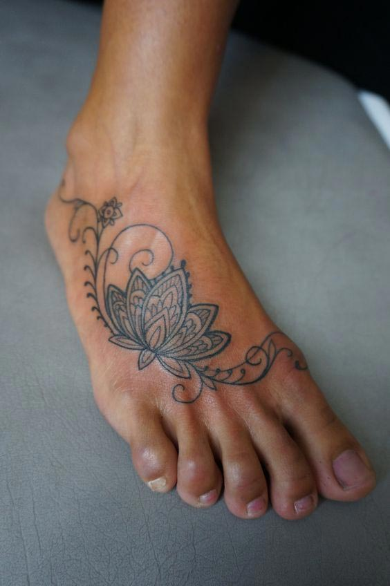 Lotus tattoo on front foot