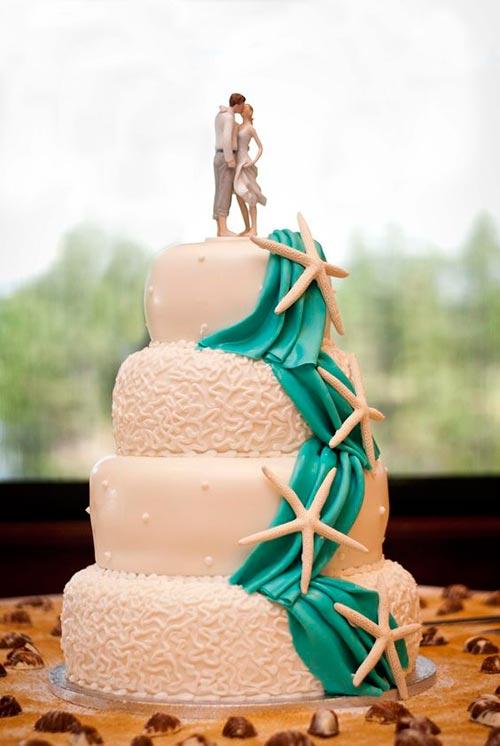 Starfishes on turquoise drape cake for beach theme wedding