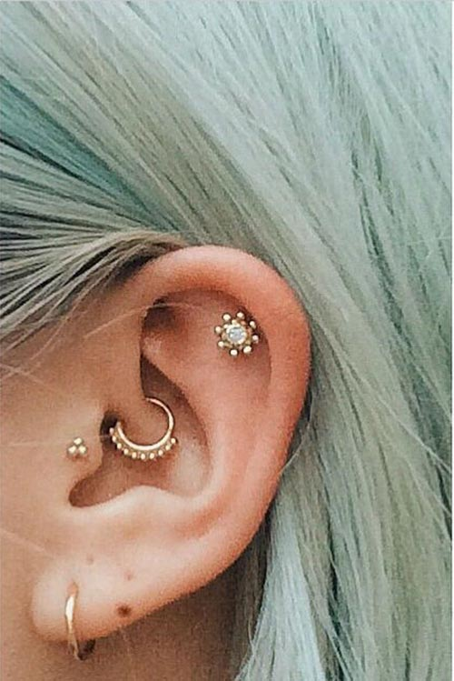 Multiple ear piercing with gold