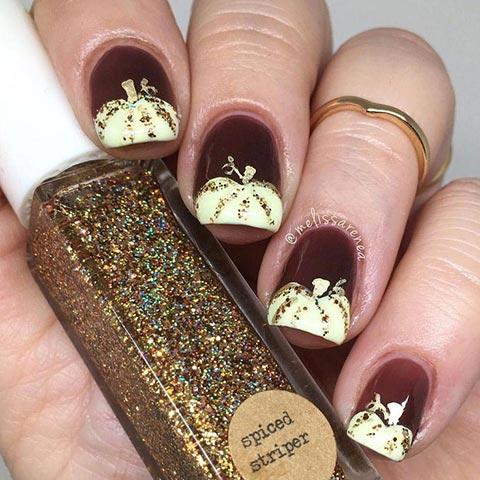 Glittery white pumpkin nail art
