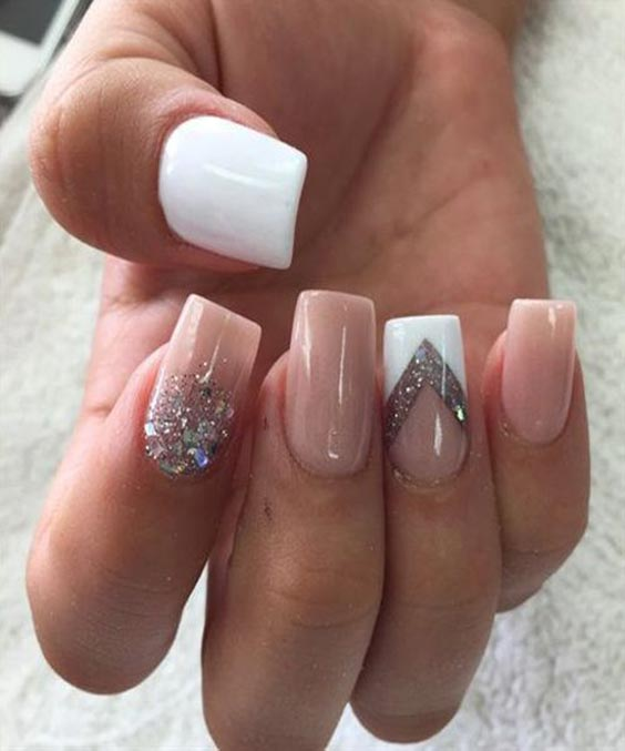 Nail art with glitter and nude