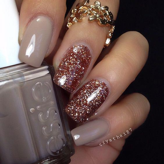 Nude shade party nails with glitter