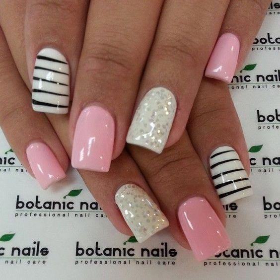 sparkling white with pink and stripes of black glitter nail art