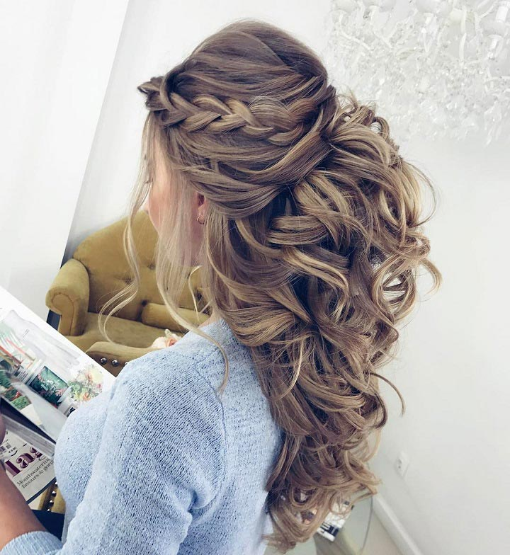 Half up hairstyle with side braid and curls