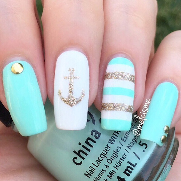 Sea blue with shimmering gold anchor nautical nail art