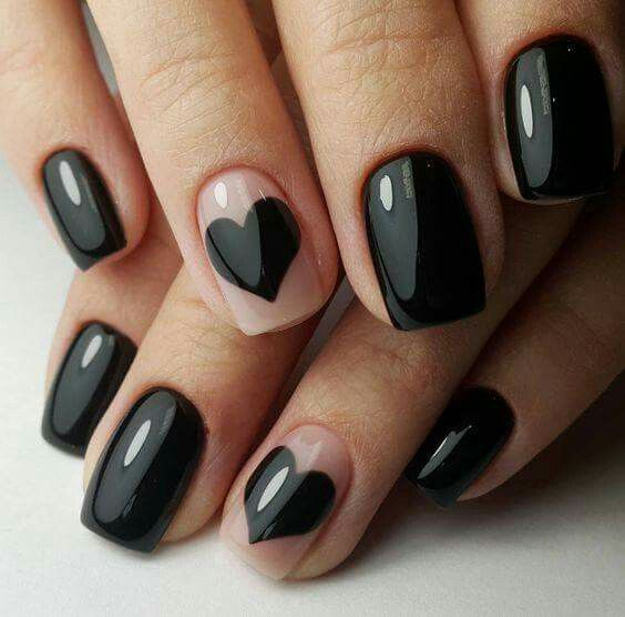 Nails with negative space and black hearts