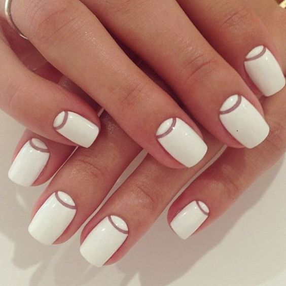 Simply stylish and easy white and negative space nail design