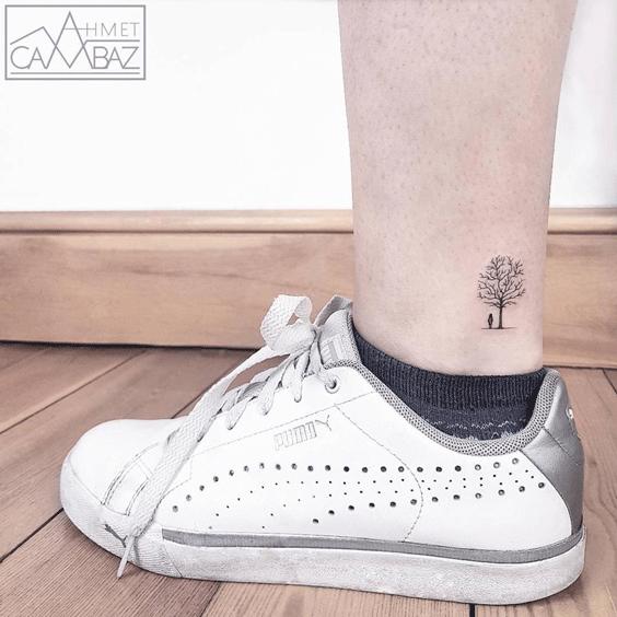 Under a tree tattoo