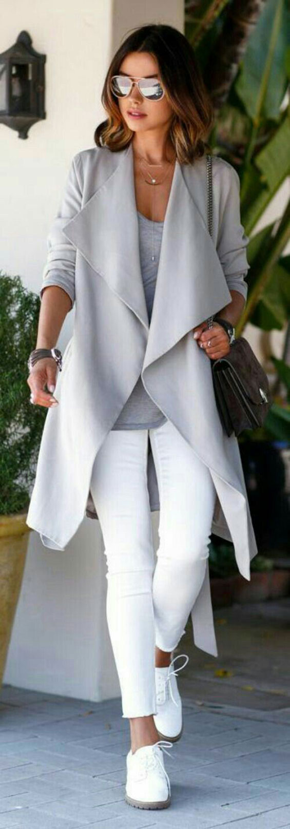 pair white jeans with cardigan