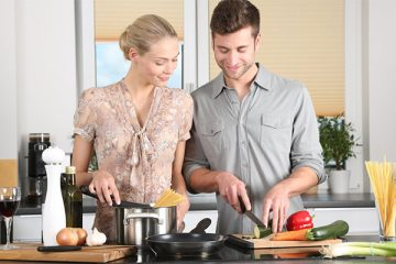 Husband and wife making food together in a healthier kitchen