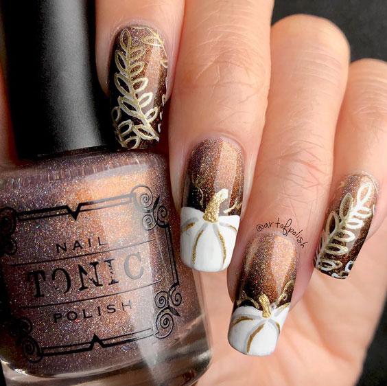 glitter and pumpkin nail art