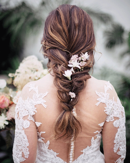 Loose braid wedding hairstyles with flowers