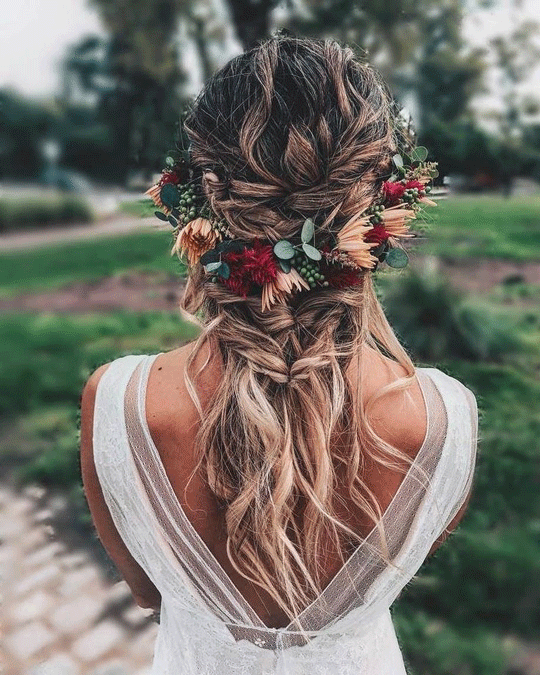 Messy twisted braid wedding hairstyles with flowers
