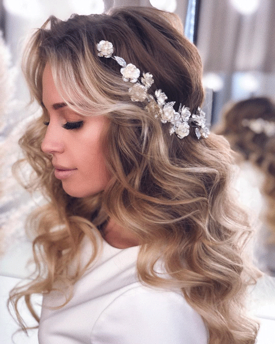 Open curls wedding hairstyles with flowers