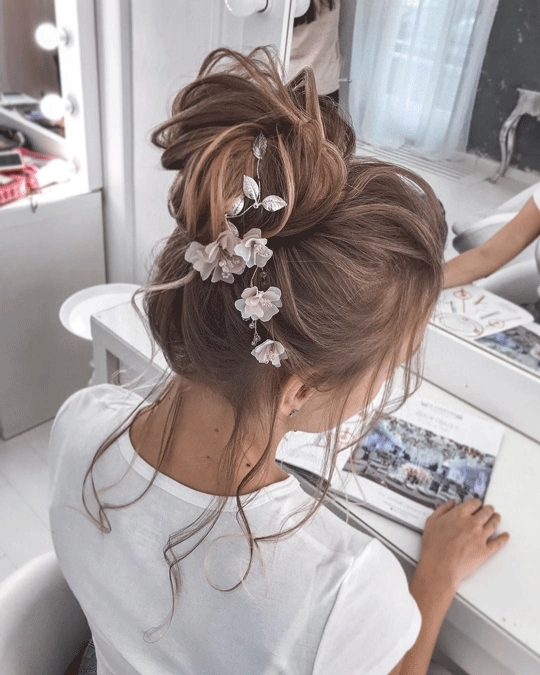 Up do flower bun hairstyle